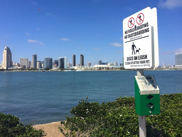 dog-poo bag dispenser coronado bay with view of San Diego skyline
