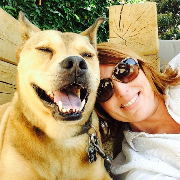 tan dog and female owner relaxing at dog friendly broadstone coronado